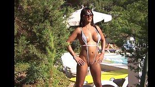 Micro sling bikini showing off