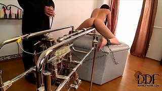 Salty brunette babe gets pounded with dildo machine