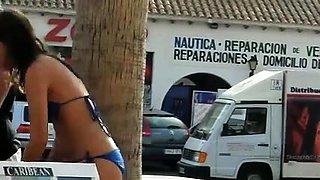 Street voyeur finds a busty brunette in a sexy blue bikini
