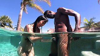 After blowing cock in the pool Asian cowgirl Marica Hase rides BBC outdoors