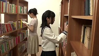 Asian school girl makes teacher squirt in library