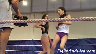 Skinny lesbians wrestling in a boxing ring