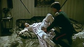 Redhead lusty milf in white stockings undressed and fucked on the bed