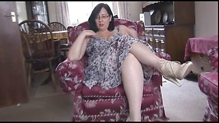 Busty mature milf in pantyhose talks dirty as she strips,