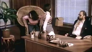 Retro sex video with two brunettes sucking a cock in an office