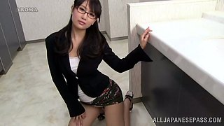 Japanese office girl puts her pantyhose on in the bathroom