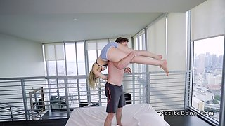 Petite blonde gets huge dick in bed