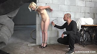 Blonde submissive slut Tyna Gold tied to a pole and abused hardcore