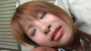 Wonderful short haired redhead from Japan gets her clit rubbed by dude