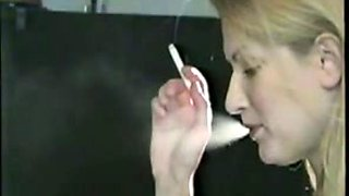 My delightful girlfriend looks hot smoking a cigarette