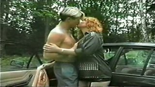 Redhead curvy pale skin busty milf in the woods with a man
