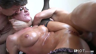 Oiled big breasted blonde whore with smeared makeup takes rough DP