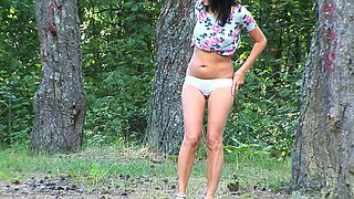 Sweet brunette Russian girl in the forest takes off her panties and pisses