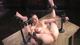 Zippered brunette slave gets pussy vibed