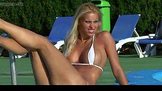 Hot blonde babe posing micro bikini and spreading