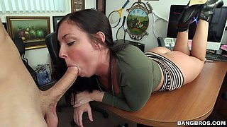 Black haired horny MILF Brittany Shae lies on office table and sucks her boss off