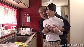 Dirty Japanese housewife gets a hardcore fuck in a kitchen