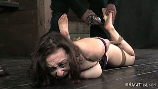 Plum brunette porn actress gets punished right on the floor