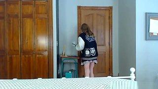 Solo pregnant girl in her cheerleader uniform posing