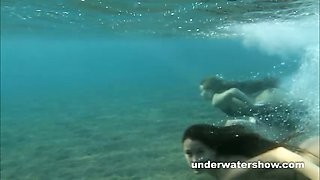 Julia and Masha are swimming nude in the sea
