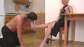 Mistress smoking erotically and getting her feet worshiped