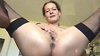 Brunette milf peeing on camera