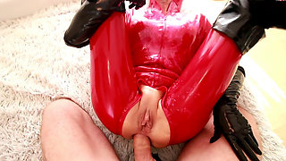 Dania red latex catsuit and black gloves