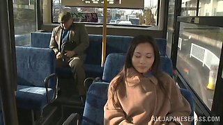 Fancy cougar dressed heavily giving a guy captivating handjob in the bus in reality shoot