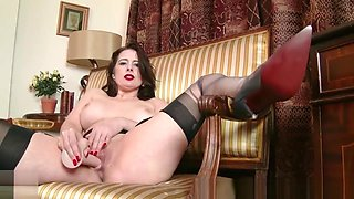 Milf Karina Currie strips off retro lingerie and toys pussy in nylons heels