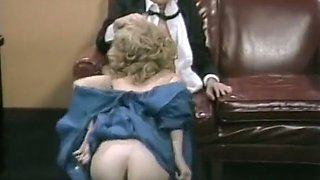 Classy light haired nympho Christy Canyon gives nice titfuck on sofa