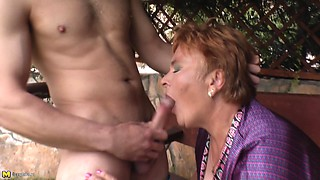 Mature short-haired chick getting the rough poking from her man
