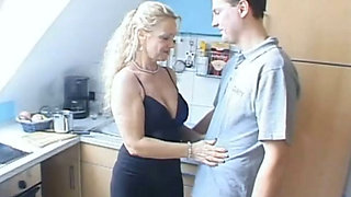 Torrid light haired mommy with giant boobs pleases her boy with solid BJ at kitchen
