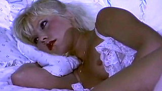 Magnificent blondie in white lingerie wants to eat cock on the bed