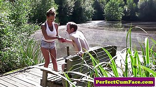 Naughty Busty femdom tugging guy outdoors for spunk