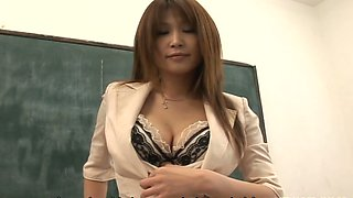 Zesty Asian teacher Ai Kurosawa flashes her boobs in college room