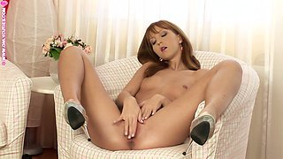 Pretty chick Satine smashes her sweet pussy with a dildo