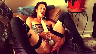 Sexy slender wife in lingerie fingers and vibrates her holes