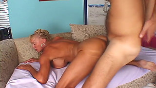 Blonde Mature with giant Fake Boobs and big Clit