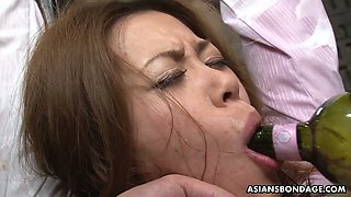 Several bad guys are toying hairy pussy of tied up Japanese chick Yui Tachiki