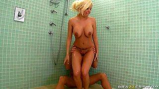 This guy squeezes fantastic boobs of Britney Amber in the shower