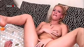 slutty blonde is masturbated by a basbeball bat and a babes fist