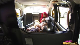 Lesbians get down to business inside a cab