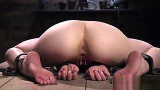Extreme back arch bondage for redhead slave