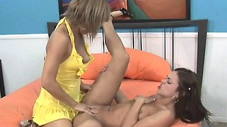 Alluring girl fucks her enticing lesbian lover with a strap-on dildo