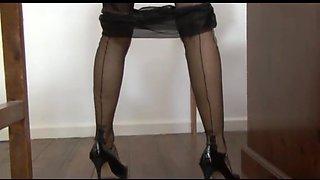 Schoolgirl talking dirty in stockings and garter belt