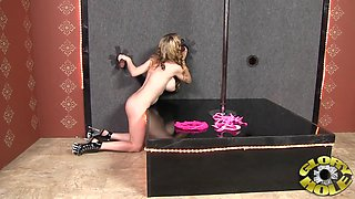 Blonde stripper removes pink bra and sucks black cock at gloryhole