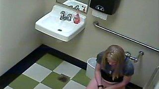 Blonde peeing in public toilet