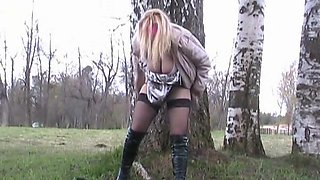 Amateur blonde is pissing outdoors