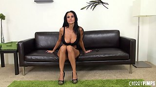 Slender Ava Addams frees her massive fake tits from a sexy bra
