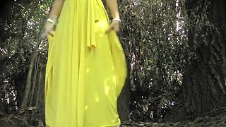 Elegant bridesmaid in a yellow dress enjoys urinating outside